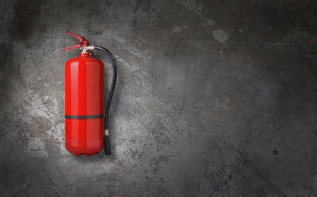 Extintor de fuego en la pared gris Foto de archivo - 59360951
