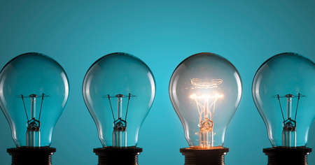 idea: Idea concept. Light bulbs on blue background