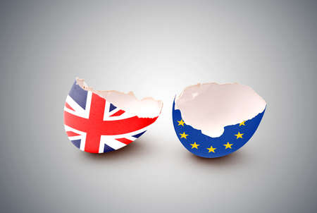 european community: Cracked egg, painted with the flag of the European Community and the United Kingdom Stock Photo