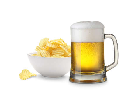 Mug of beer and potato chips bowl isolated on white background Stock Photo