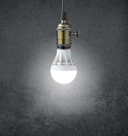 e27: Glowing LED bulb on grunge wall