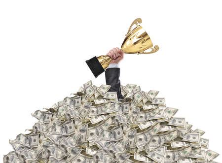 one hundred dollars: hand of a man stuck in a pile of money holding a cup trophy above the surface Stock Photo