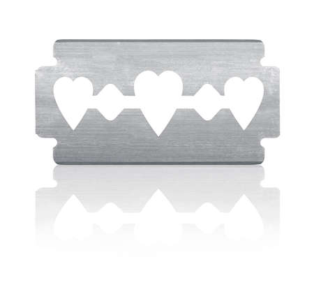 blades: Razor blade with heart shape and reflection. Isolated on white