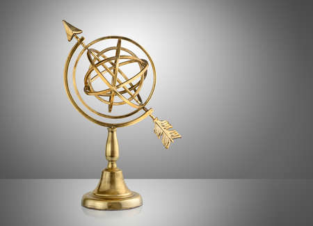 Vintage armillary sphere on gray background