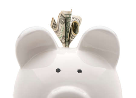Close-up white piggy bank and US dollars. Isolated on white background Foto de archivo