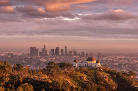 Griffith Observatory and Los Angeles city skyline at sunset Stock Photo