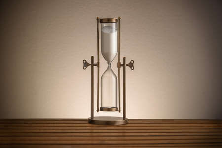 vintage hourglass on wooden table