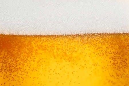 close up beer with foam and bubbles