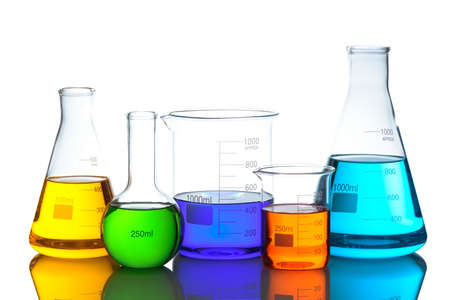 Laboratory glassware set with color liquid and reflection. Isolated on white background Stockfoto