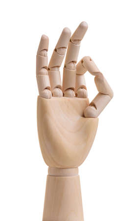 Wooden hand shows ok gesture. Isolated on white background