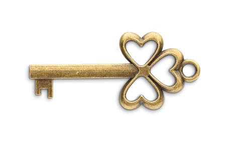 Vintage golden skeleton key isolated on white background Archivio Fotografico