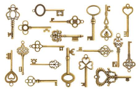 Set di chiavi di scheletro d'oro d'epoca isolato su sfondo bianco Archivio Fotografico