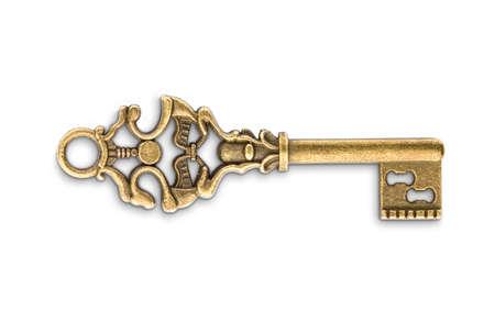 Chiave di scheletro dorata d'epoca isolata su sfondo bianco Archivio Fotografico