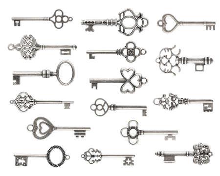 Set of vintage silver skeleton keys isolated on white background