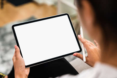 Young woman holding digital tablet with a blank screen, for putting advertising to promote.