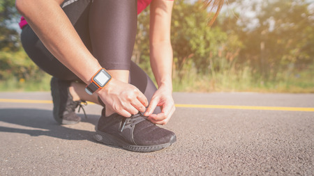 Women exercise in the morning with SmartWatch. 版權商用圖片
