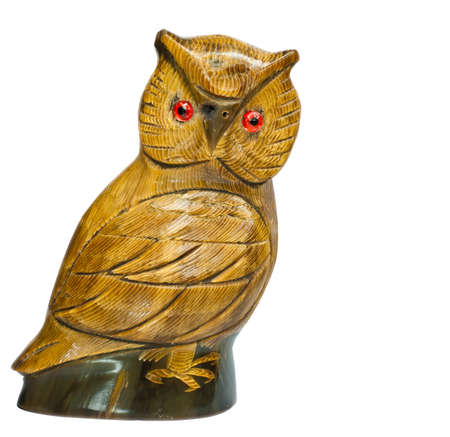 wood figurine: Wooden owl carved on a white background