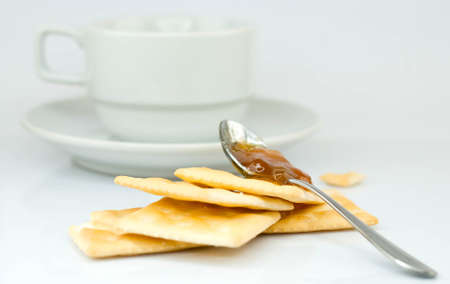 saltine crackers and jam On a white background  photo