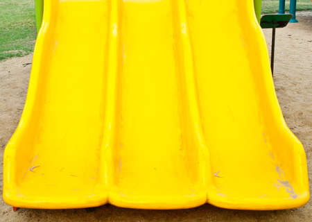 yellow plastic slide detail at kids playground