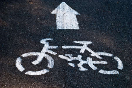 bicycle road sign in garden photo