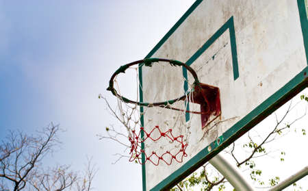 intramural: old wooden basketball hoop in the park