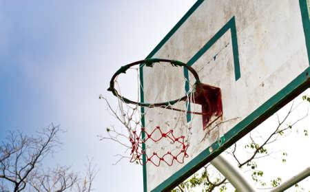 intramural: old wooden basketball hoop in the park