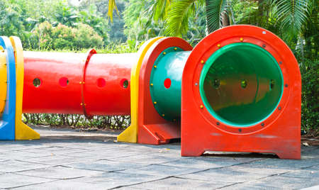 colorful tube in playground of garden Stock Photo