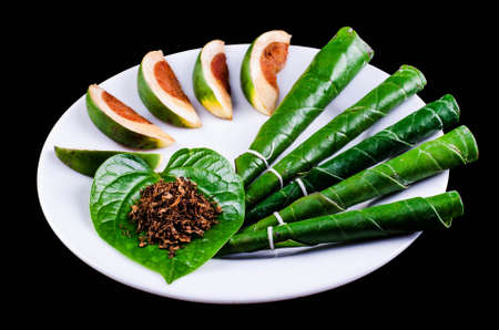 Areca nut, betel nut chewed with the leaf is mild stimulant.