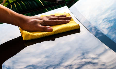 cleaning her new car using microfiber cloth Stock Photo - 19425737