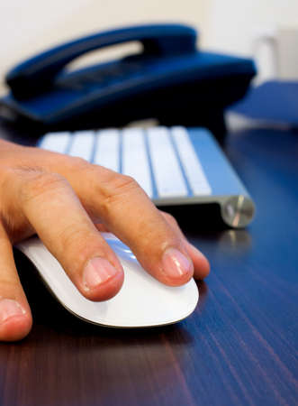 Image of hands clicking computer mouse Stock Photo - 20108741