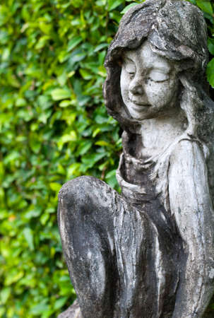 Statue of a little girl in the park photo