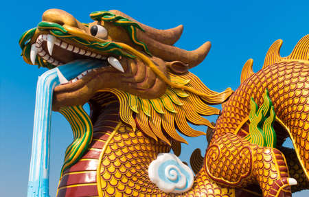Golden Dragon statue at Suphanburi, Thailand photo