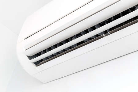 Closeup white air conditioner in room Banco de Imagens