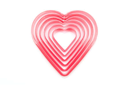 cookie cutter: Heart shaped cookie cutter on white background Stock Photo