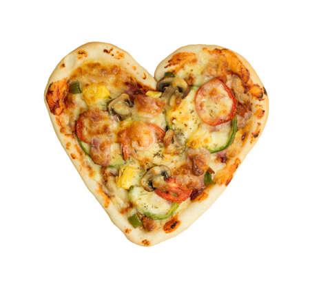Heart shaped pizza on wood Stock Photo