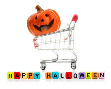 Happy Halloween  Pumpkin, Jack O Lantern in Shopping supermarket cart and colorful wooden blocks with  against white background