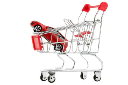 Buying a new car ,Car in  shopping cart isolated on white background