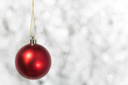 Red christmas ball  isolated on White bokeh background