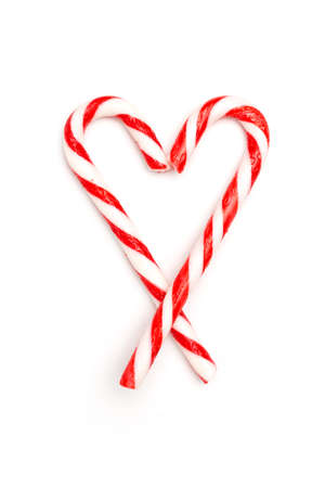 Heart made of candy canes isolated on white background