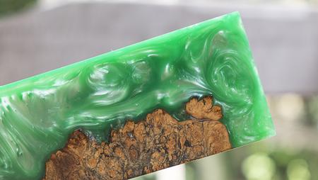 casting epoxy resin burl wood green background