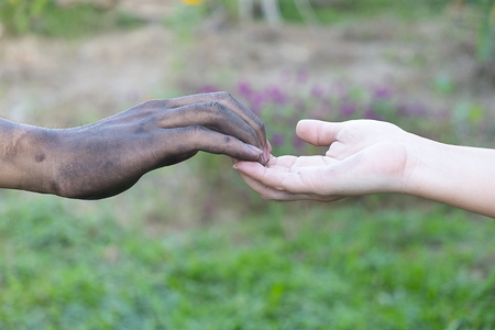 close up man and woman hands touching together with a dirty hand and a clean  on blurred background for love concept valentine day, Stained Banco de Imagens