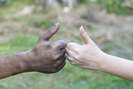 close up man and woman hands touching holding together on blurred background for love concept, shake hand with a dirty hand and a clean, Stained, hapy valant, valentine day, making an agreement