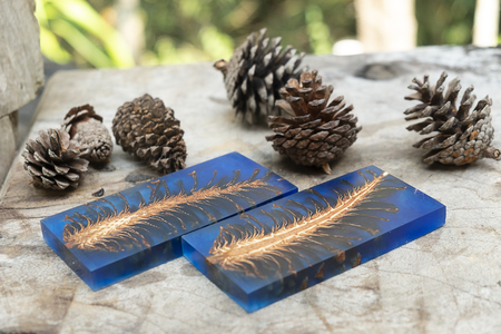 casting epoxy resin Stabilizing pine cone red blue abstract art blur background, Texture of a wooden blanks