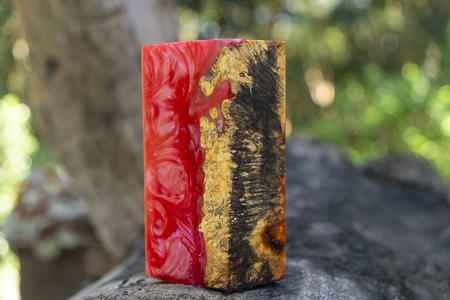 casting epoxy resin Stabilizing Afzelia burl exotic wood red yellow background, Abstract art picture photo, print design and your advertisement, hybrid