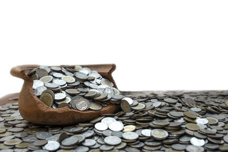 Coins in jar on wooden with blurred background, Money stack for business planning investment and saving concept