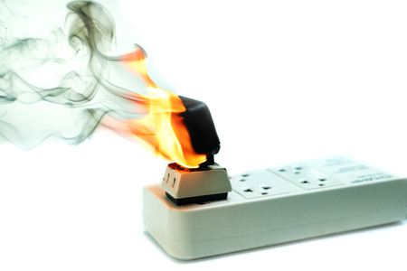 On fire electric wire plug Receptacle and adapter on white background, Electric short circuit failure resulting in electricity wire burnt