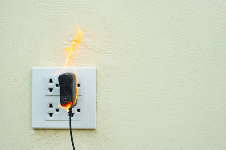 On fire electric wire plug Receptacle and adapter on partition, Electric short circuit failure resulting in electricity wire burnt Banco de Imagens