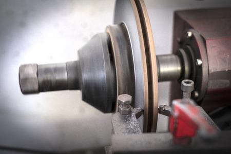 Brake lathe tool polishing disc brakes of cars working automatic