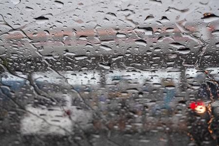 Picture Inside water rain drops on car window glass