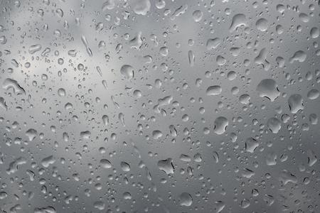 Picture Inside water rain drops on car window glass 免版税图像